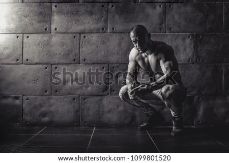 Strong bodybuilder athletic man pumping up muscles workout bodybuilding concept background - muscular bodybuilder handsome men doing exercises in gym naked torso