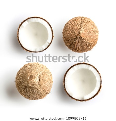 Tropical fruit whole and half abstract background .Coconut on white background. from top view #1099803716