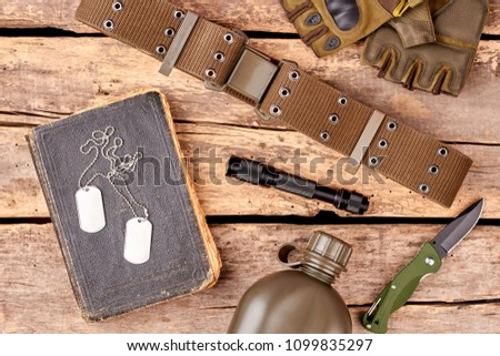 Military soldier's items, flat lay. Accessories and souvenirs.