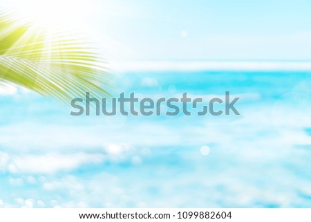 Blur beautiful nature green palm leaf on tropical beach with bokeh sun light wave abstract background. Copy space of summer vacation and business travel concept. Vintage tone filter effect color style #1099882604