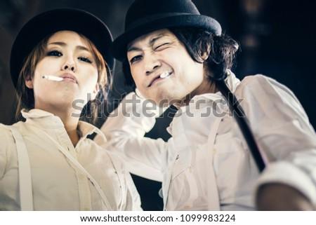 NAGOYA, JAPAN - NOVEMBER 1, 2015: A couple people in costume celebrate Halloween in one of the large annual block parties near Ikeda Koen (Ikeda Park) in Nagoya. #1099983224