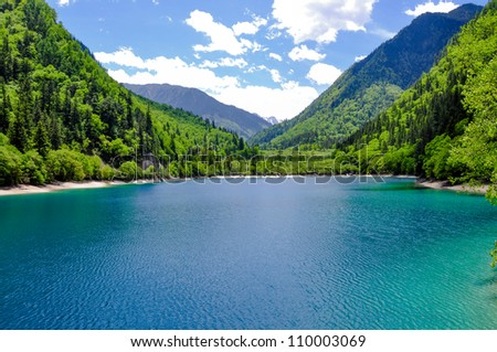 View of Panda Lake at Jiuzhaigou.  Jiuzhaigou is a nature reserve famous for its colorful lakes located in the Tibetan-Qiang, Sichuan. It is one of the most visited sites in China. #110003069