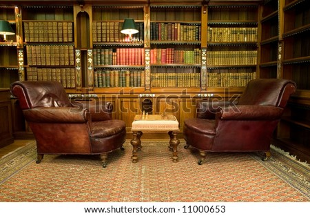 Old studying room with two leather armchairs and chess game #11000653