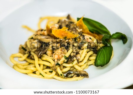 Pasta in souce on plate. Delicious pasta. Food detail.Traditional italian cuisine #1100073167