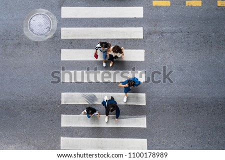 Aerial photo top view of people walk on street in the city over pedestrian crossing traffic road #1100178989