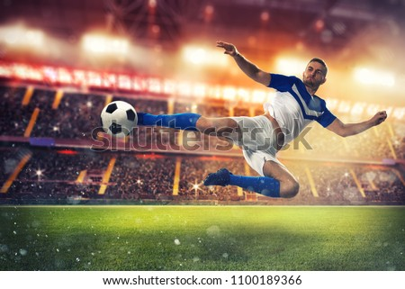 Soccer striker hits the ball with an acrobatic kick Royalty-Free Stock Photo #1100189366