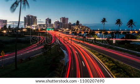Traffic entering the capital of Puerto Rico at night. Royalty-Free Stock Photo #1100207690