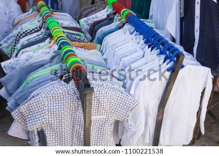 BUKHARA, UZBEKISTAN - MAY 25, 2018: Silk and Spices Festival 2018. Local dress producers exhibition in Bukhara, Uzbekistan #1100221538