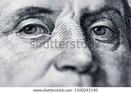 Benjamin Franklin's look on a hundred dollar bill. Benjamin Franklin portrait macro usa dollar banknote or bill Royalty-Free Stock Photo #1100241140