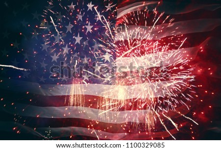 Patriotic holiday. The USA are celebrating 4th of July. American flag on background of fireworks. #1100329085