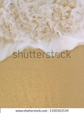 Sea ocean wave on sand beach Background #1100363534