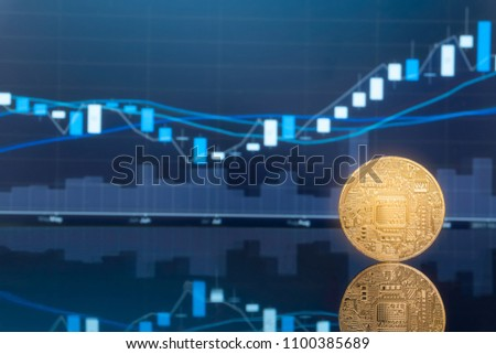 Initial coin offering (ICO) and digital money investing concept - Physical metal digital coins with blue global trading exchange market price chart in the background. #1100385689
