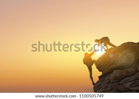 Asia couple hiking help each other silhouette in mountains with sunlight. #1100505749