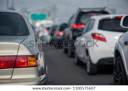 traffic jam with row of cars on toll way, rush hour #1100575607
