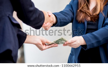 business handshake and teamwork for money and success goal #1100662955