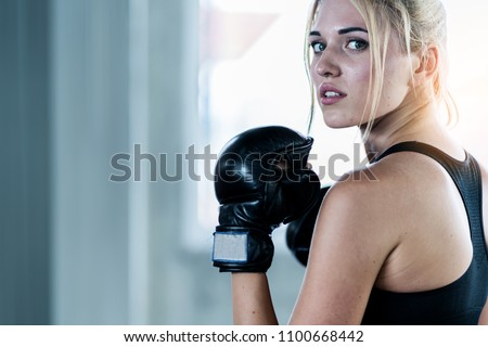 attractive caucasian woman workout with boxing in gym fit and firm concept Royalty-Free Stock Photo #1100668442