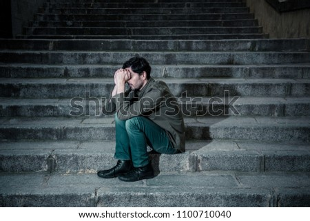 latin man stressed from work sitting on steps outside feeling anxiety in adult cause of depression and problem in living that makes you feel lonely, sad and worried in mental health concept #1100710040