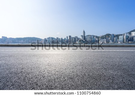 empty asphalt road with panoramic city skyline #1100754860