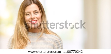Young beautiful woman confident and happy with a big natural smile laughing #1100770343