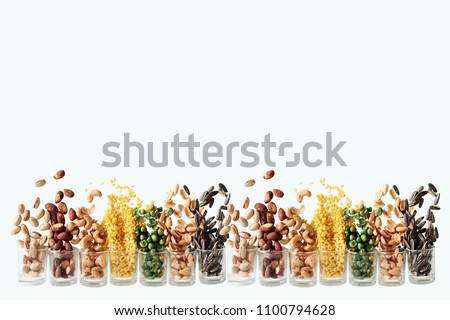 Mix Nuts in the glass on white background close up nuts pistachios  almond cashew nuts peanut sunflower seeds #1100794628