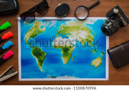 World map on a wooden table top view. Concept travel adventure vacation #1100870996