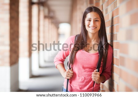 A portrait of a hispanic college student at campus