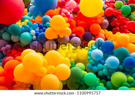 Bright abstract background of jumble of rainbow colored balloons celebrating gay pride #1100995757