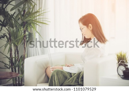 Asian woman using laptop, workplace at home . Concept of Asian woman lifestyle. #1101079529