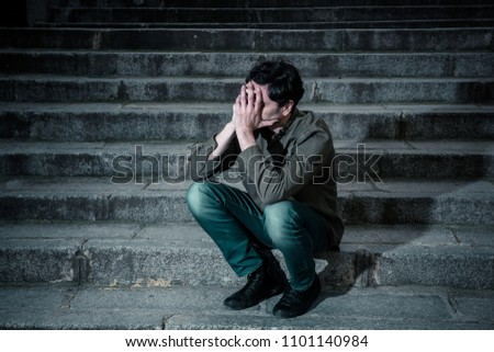 latin man stressed from work sitting on steps outside feeling anxiety in adult cause of depression and problem in living that makes you feel lonely, sad and worried in mental health concept #1101140984