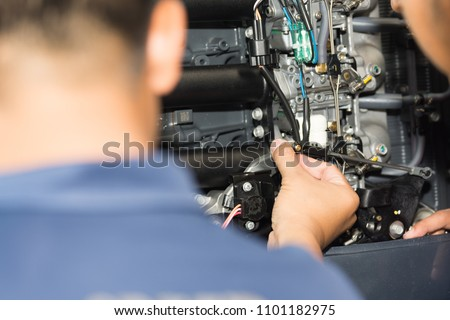 Boat mechanic is repairing the engine of the ship, Ship engine equipment. #1101182975