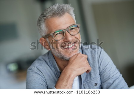 Middle-aged guy with trendy eyeglasses Royalty-Free Stock Photo #1101186230