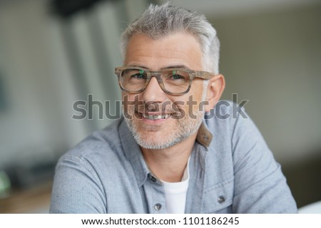 Middle-aged guy with trendy eyeglasses #1101186245