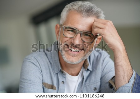 Middle-aged guy with trendy eyeglasses #1101186248