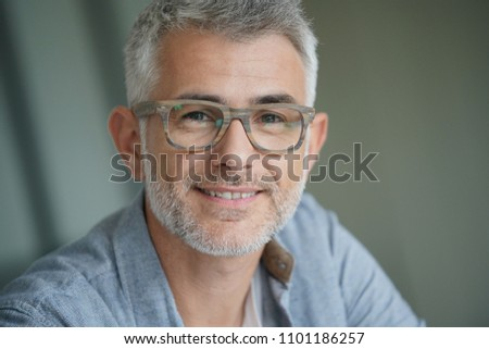 Middle-aged guy with trendy eyeglasses #1101186257
