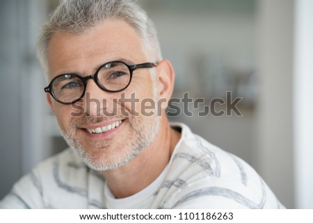 Middle-aged guy with trendy eyeglasses #1101186263