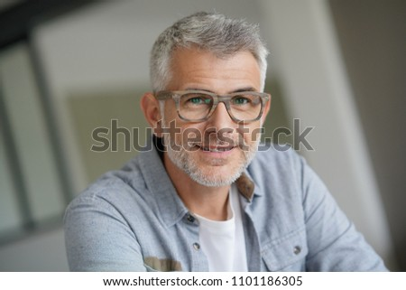 Middle-aged guy with trendy eyeglasses #1101186305