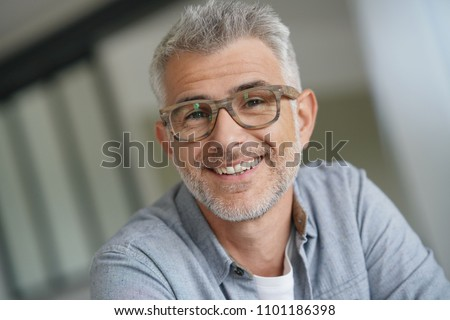 Middle-aged guy with trendy eyeglasses #1101186398