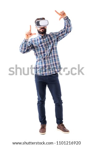 Young bearded adult business man wearing vr-glasses with zooming or resizing augmented screen gesture. Full body isolated on white background.
