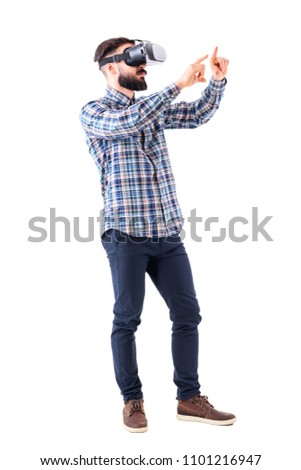 Side view of business man with virtual reality glasses doing resize or zoom gesture with fingers. Full body isolated on white background.