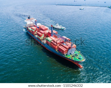 An aerial photograph of a large ship towing a small ship. #1101246332
