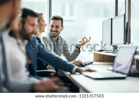 Picture of business people working together in office #1101357503