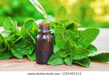 The mint extract in a small jar. Selective focus. #1101401111