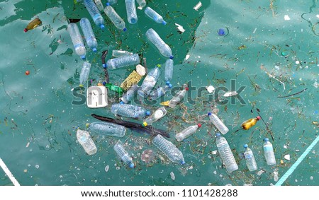 Plastic bottle in the ocean sea water  Royalty-Free Stock Photo #1101428288