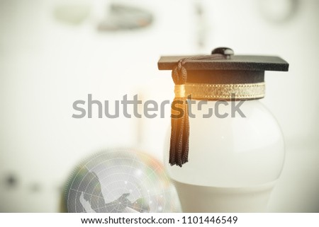 Graduate study or Education knowledge concept: Graduated cap put on white light bulb and earth model radar background. Concept for Educational is Navigation light for successs study or business world #1101446549