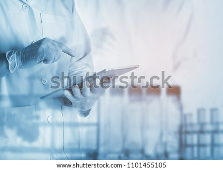 scientist using tablet in the laboratory,Laboratory research concept,science background #1101455105