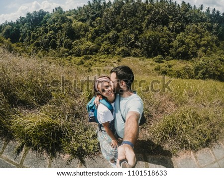 Young and inlove couple in their honeymoon travling around Bali, Indonesia. Enjoying a day of sightseeing together discovering incredible jungle landscapes. Travel Photography. #1101518633