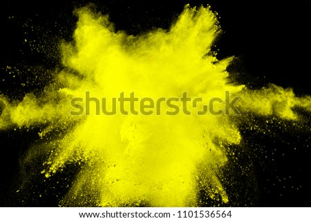 abstract yellow dust explosion on  black background #1101536564