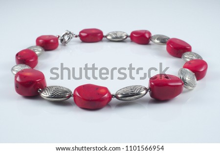 Red glass coral metal necklace isolated on white #1101566954