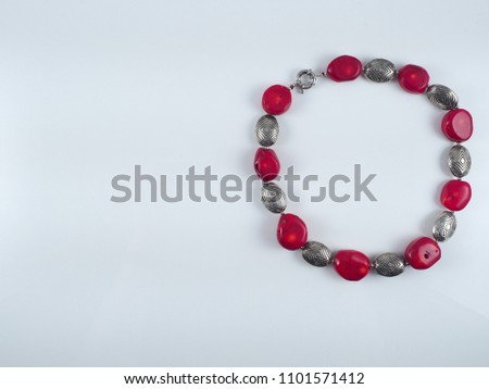 Red glass coral metal necklace isolated on white #1101571412