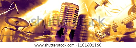 Live music and concert.Guitarist and drummer.Night entertainment and festival events.Musical performance on stage.Recreation and music show. Royalty-Free Stock Photo #1101601160